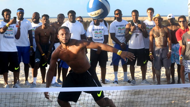 MTSU's Shane Tucker goes after a ball during a version of pickleball as his teammates cheer him on during the Player Beach Bash and Dinner at the Atlantis in the Bahamas on Monday.