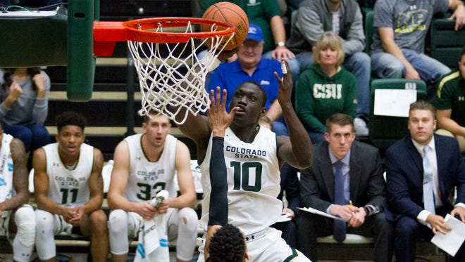 CSU's Che Bob shoots over New Mexico State's Matt Taylor during Sunday's game at Moby Arena. Bob scored 11 points and pulled down eight rebounds for the Rams in the 64-61 win.