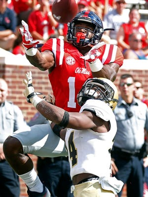 Ole Miss freshman wide receiver D.K. Metcalf reaches over Wofford cornerback Devin Watson to catch a 10-yard touchdown pass in the first half. Metcalf didn't return in the second half after breaking his left foot.