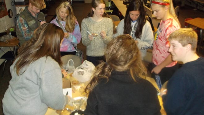 Members of the Key Club, a service group at Stevens Point Area Senior High, package and price items for a bake sale