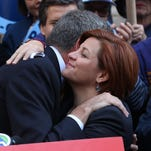 Christine Quinn, New York City Council Speaker and former mayoral hopeful, hugs Democratic Party nominee Bill de Blasio at a news conference where Quinn endorsed de Blasio on Sept. 17 in New York City.