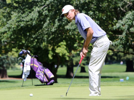 Clemson's Carson Young putts during the 2016 NCAA Men's