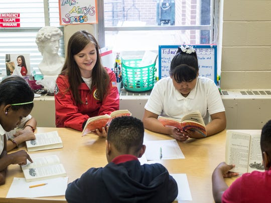 May 18, 2017 - Mary Davega reads to students at Brownsville Elementary school during a Tier 2 City Year class. City Year, an Americorps program that supports schools in poor areas, is wrapping up its first year in Memphis. The program employs recent college graduates to work in support roles in schools, focusing on issues like attendance and behavior.