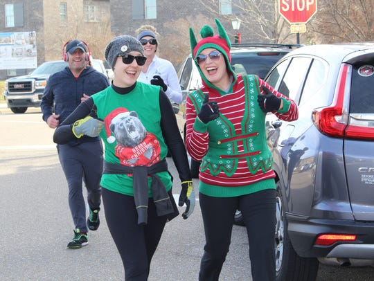 Kim Jamison, left and Angela Foshee head for home during