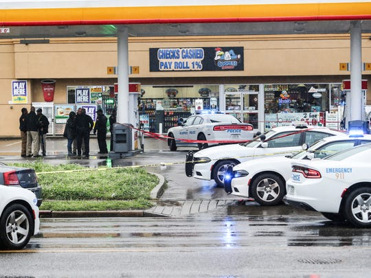 April 14, 2018 - Memphis Police investigate the scene of an officer-involved shooting at a gas station on Millbranch near Shelby Drive.