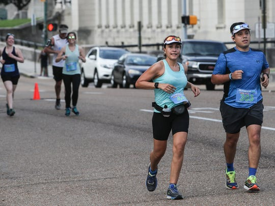 Runners make their way north on Third Street during the Memphis in May 2018 Great American River Run on May 26, 2018.