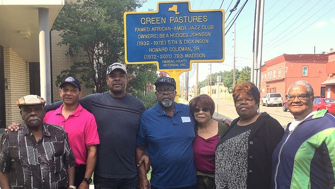 Members of Howard Coleman's family stand in front of a new historical marker at the original site of Elmira jazz club Green Pastures, which Coleman managed and eventually owned. From left are Coleman's brother Winston, his nephew Edward Brown, son Howard Coleman Jr., brother Roland Coleman, widow Varneze Coleman, daughter Candice Coleman Ross, and niece Ozella Brown.