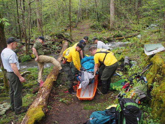Great Smoky Mountain National Park search and rescue personnel tend to Michael Aday.