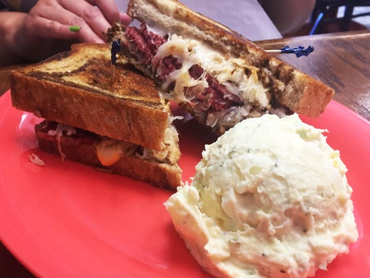 The Reuben ($8.75), with house-made corned beef, sauerkraut, Swiss cheese, Thousand Island dressing on marble rye, at Urban Cafe in Las Cruces.