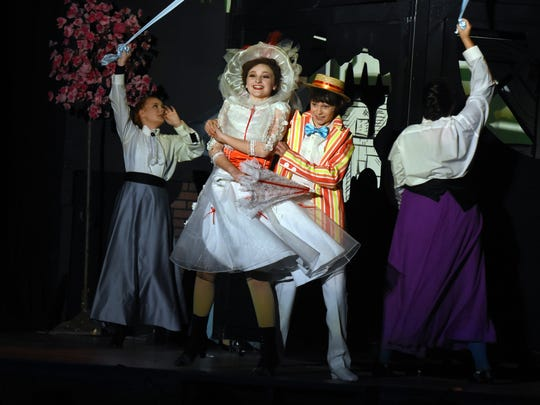 Mary Poppins (Kylie Vandergriff) and Bert (Noah Crabtree) dance during a magical adventure in the park.