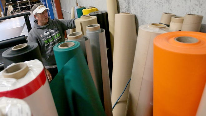 "Self-proclaimed ""fabric geek"" Deano Perlatti talks about the different types of fabric used at Tarp Innovators in Poulsbo."