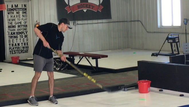 Route 1 Hockey founder A.J. Aitken works on passing skills with students at Route 1 Hockey. Aitken opened the off-season hockey training space this month.