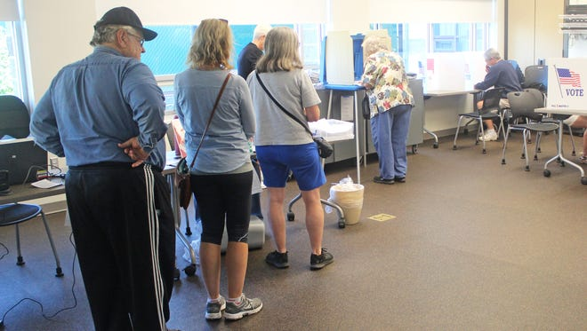 Voters line up at the North Liberty Community Center to cast votes in the Iowa City Community School Board election on Sept. 12, 2017.
