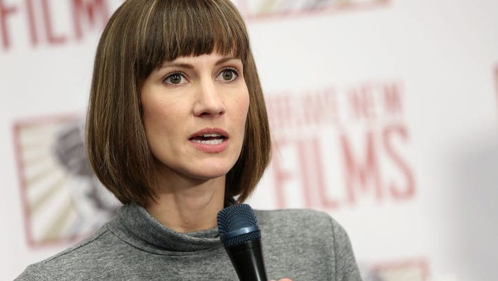 Rachel Crooks speaks during the press conference held