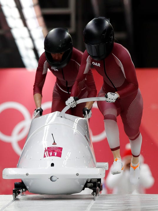 Driver Nadezhda Sergeeva and Anastasia Kocherzhova of the Olympic Athletes of Russia start their first heat during the women's two-man bobsled competition at the 2018 Winter Olympics in Pyeongchang, South Korea, Tuesday, Feb. 20, 2018. (AP Photo/Andy Wong)