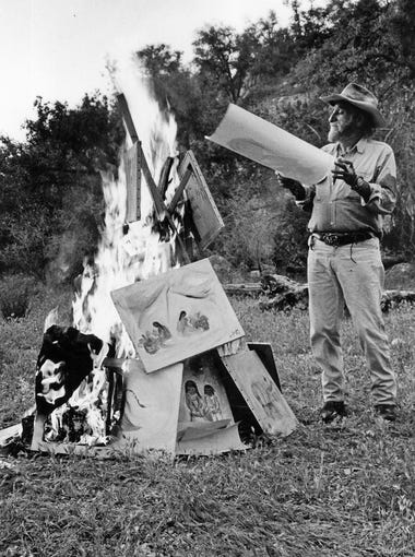 Artist Ted DeGrazia burns his paintings in the Superstition