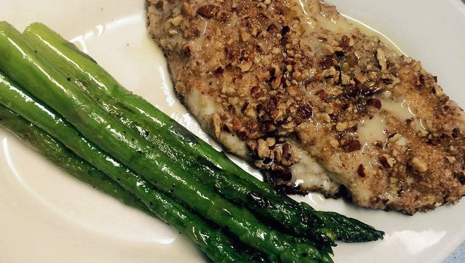 This grouper dish topped with pecans is served at Milwaukee Steakhouse, 6024 W. Blue Mound Road.