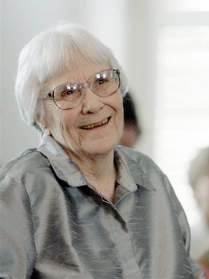 """Harper Lee, author of the Pulitzer Prize-winning novel, """"To kill a Mockingbird,"""" smiles during a ceremony honoring the four new members of the Alabama Academy of Honor at the Capitol in Montgomery, Ala. Publisher Harper announced Tuesday that """"Go Set a Watchman,"""" a novel Lee completed in the 1950s and put aside, will be released July 14. It will be her second published book."""