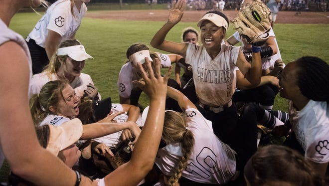 Powell's Mackenzie Hayles (2) celebrates with teammates after a Class AAA TSSAA Softball State Tournament championship game between Powell and Walker Valley Friday, May 25, 2018. Powell defeated Walker Valley 2-1.