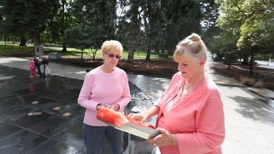 Charlotte King, right, meets with Mary Fisher at the