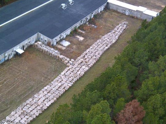 This aerial photo shows some of the millions of pounds of smokeless explosive powder found in late 2012 improperly stored at Explo Systems Inc., a munitions dismantling facility at Camp Minden at Doyline.