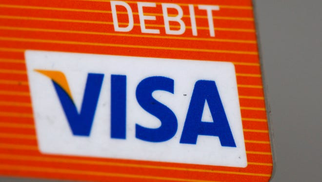 This file photo shows the Visa logo on the front of a Debit Card (AP Photo/Matt Rourke)