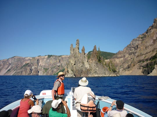 Park rangers give interpretative talks during boat tours on Crater Lake. The tours leave six times per day during the summer, with two of the trips dropping people off on Wizard Island.