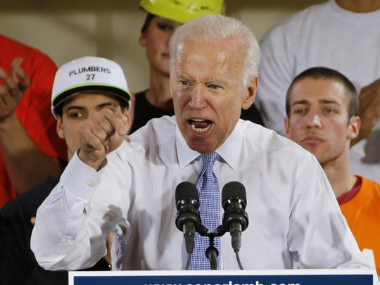 FILE- In this March 6, 2018 file photo, former Vice President Joe Biden speaks at a rally in Collier, Pa. Biden is picking Pennsylvania for the site of his first stump speech of the presidential campaign, sending a clear signal that he intends to own what may be the race's hardest-fought battleground of 2020. (AP Photo/Gene J. Puskar, File)