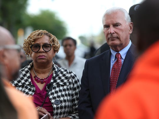 Wilmington city council president Hanifa Shabazz (left) and Mayor Mike Purzycki listen to a member of the Wilmington Peacekeepers speak during a prayer vigil for a 6-year-old boy who was shot and critically wounded in Wilmington.