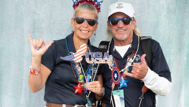 Special Olympics coaches Nancy and Michael Howard pose at the National Games Seattle in 2018.