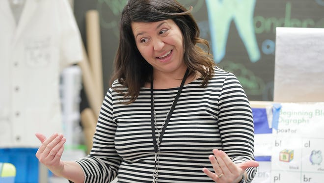 Golden Apple winner Michelle Flicek, a first-grade teacher at King Elementary School, teaches her students in March.