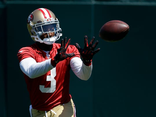 FILE - In this June 17, 2014, file photo, San Francisco 49ers wide receiver Bruce Ellington catches a pass during during NFL football minicamp in Santa Clara, Calif. Gone are the days when Bruce Ellington would rush from a basketball workout with South Carolina teammates to a football meeting room to learn the complex schemes of coach Steve Spurrier. Ellington's only focus is the San Francisco 49ers and making an impact on the NFL.  (AP Photo/Jeff Chiu, File)