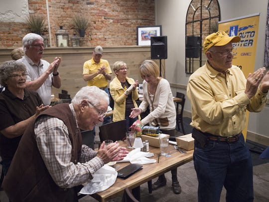 Wyoming fans sing the Cowboys fight song during a radio show Altitude Chophouse and Brewery in Laramie Wednesday, September 28, 2016.