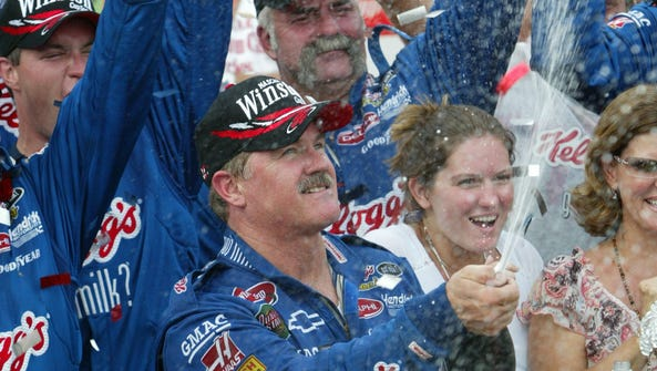 Terry Labonte sprays champagne in Victory Lane after