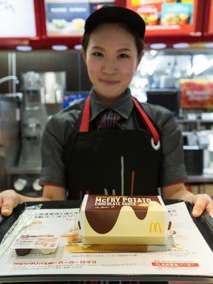 McDonald's Japan manager Miwa Suzuki presents a box of McChoco Potato on Jan. 25, 2016, in Tokyo.