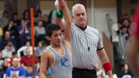 Dennis Robin of Arlington faces off against Ivan Garcia