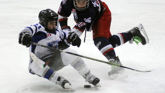 Northumberland Nighthawks Zack Dewar is tripped up as he skates to the net by Vaughan Rangers' Nicholas De Santis Sunday, Jan. 29, during the Silver Stick Finals PeeWee AA Championship game at McMorran Arena.