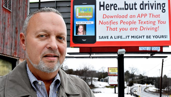 John Trone, a Spring Grove resident and owner of Trone Outdoor Advertising is shown with one of four billboards on display in the area that he donated to urge people to stop using their phones while driving, in Hanover, Pa. on Wednesday, Feb. 3, 2016. (Dawn J. Sagert - The York Dispatch)