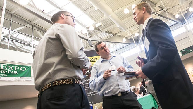 Consolidated Electrical Distributors Inc. (CED) representatives Jeremy Wiest, left, and Jason Kyle, center, talk with freshman Alex Roppett about internship opportunities during the York College Career Expo Wednesday, March 16, 2016, at the college's Grumbacher Center. Amanda J. Cain photo