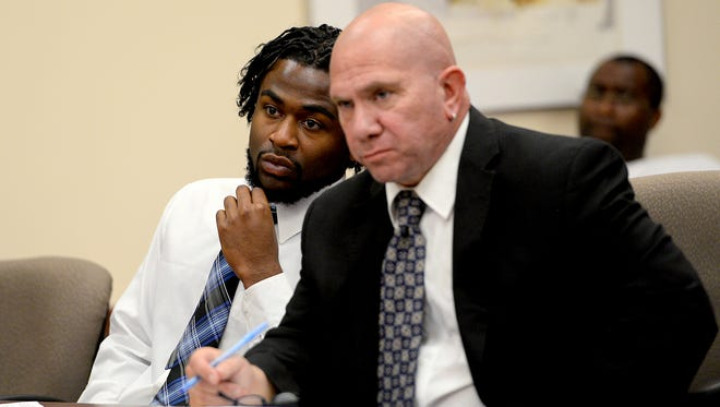 Charles Lewis Jr., left, listens to proceedings with his attorney Keith Watson, during a status hearing in Judge George Economy's courtroom Tuesday, August 9, 2016 in Lansing. Lewis was 13 when he was involved, with members of a gang, in the 2010 killing of 19-year-old Shayla Johnson. Lewis was convicted in juvenile court of first-degree murder.