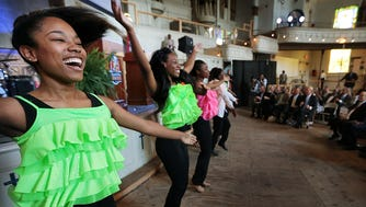 Erinn Robinson (left) and fellow Overton High School CAPA Dancers perform at the start of the Memphis Music Hall of Fame induction announcements at Clayborn Temple Tuesday afternoon.