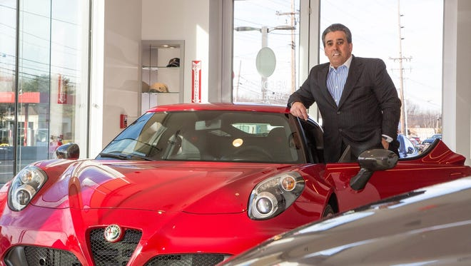 Celebrity Motor Car CEO/Principal Tom Maoli with the new Alfa Romeo Giulia Quadrifoglio RWD, a 500 plus horsepower performance vehicle.