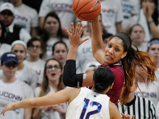FILE - In this Feb. 13, 2017, file photo, South Carolina's A'ja Wilson, top, is guarded by Connecticut's Saniya Chong (12) in the second half of an NCAA college basketball game in Storrs, Conn. Wilson is chronicling her path from the end of her college career to the start of her WNBA career, including getting drafted. (AP Photo/Jessica Hill, File)