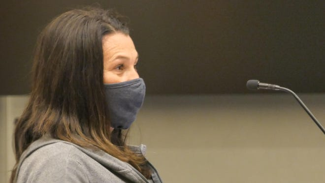 Nicole Heneha, a mother of children in Hutchinson Schools, tells the school board on Nov. 9 that keeping kids home from school is detrimental to them.