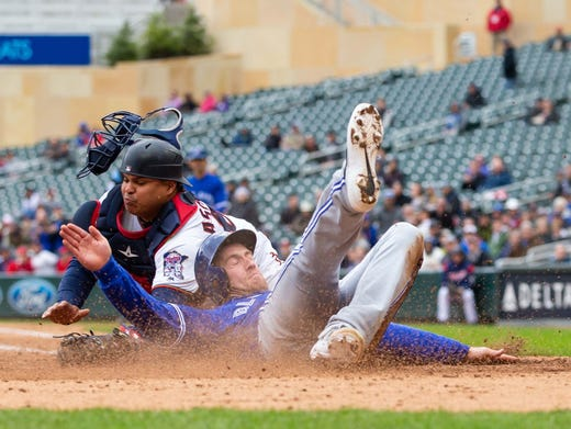 Toronto Blue Jays outfielder Billy McKinney beats the tag from Minnesota Twins catcher Willians Astudillo in the fourth inning at Target Field in Minneapolis. BRAD REMPEL, USA TODAY Sports