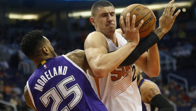 Phoenix Suns center Alex Len is fouled by Sacramento Kings forward/center Eric Moreland during preseason NBA action at Talking Stick Resort Arena in Phoenix on Oct. 6, 2015.