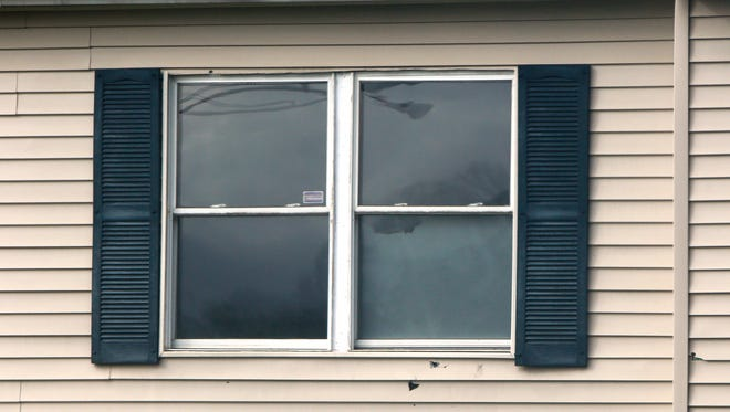 More than a month after bullets ripped through a Casey Drive apartment, damage still remains on the Northside building.
