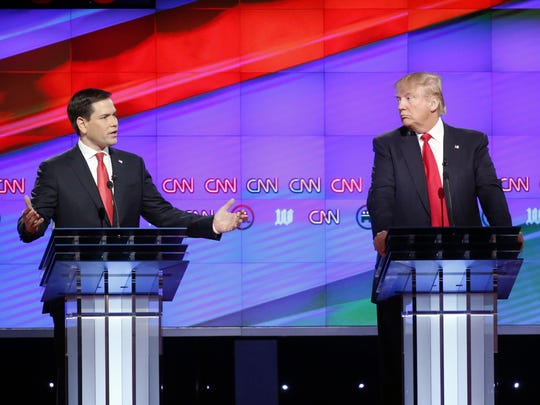 Republican presidential candidate Sen. Marco Rubio, R-Fla., left, speaks as Donald Trump listens, during a Republican presidential debate in 2016 at the University of Miami in Coral Gables, Fla.