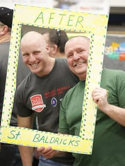 Fond du Lac Fire/Rescue members Brett Atfty and Steve Piper pose after they got their hair shaved off at the St. Baldrick's Festival at the Fond du Lac County Fairgrounds Sunday, March 26, 2017. The event raises money for child cancer patients.
