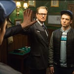 """Colin Firth and Taron Egerton appear in a scene from """"Kingsman: The Secret Service."""""""